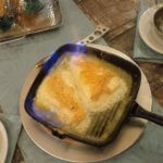 Flaming Saganaki Cheese in cast iron pan