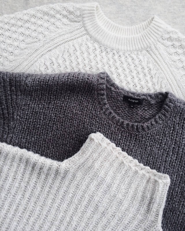 three-sweaters-laying-flat