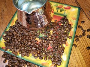 coffee beans with briki pot