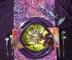 purple plate with flower plate on top