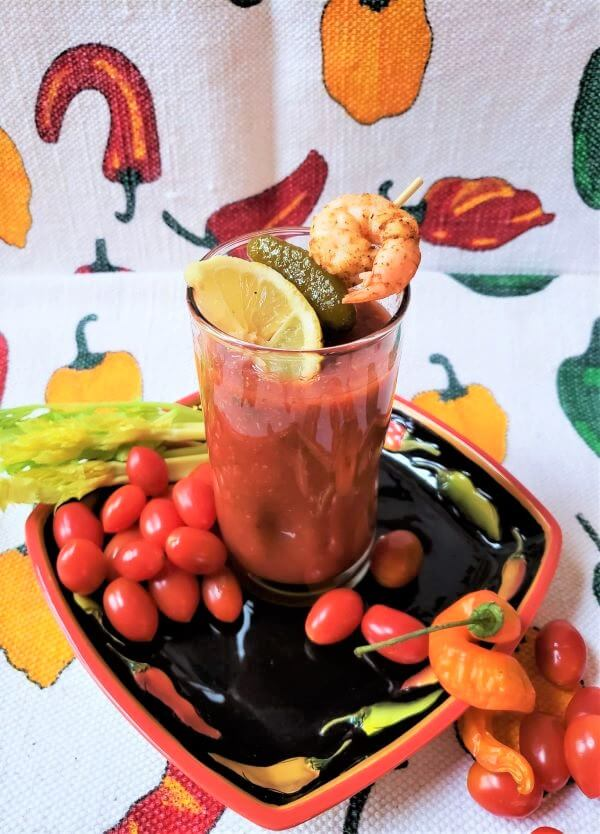 big batch bloody mary mix with garnishes