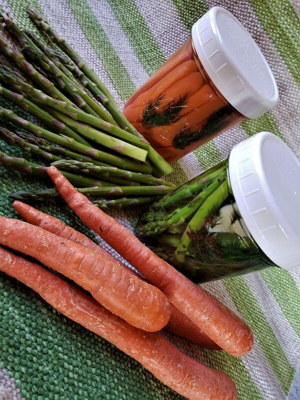 pickled carrots and asparagus in jars