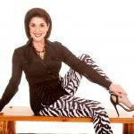 woman in zebra pants on bench