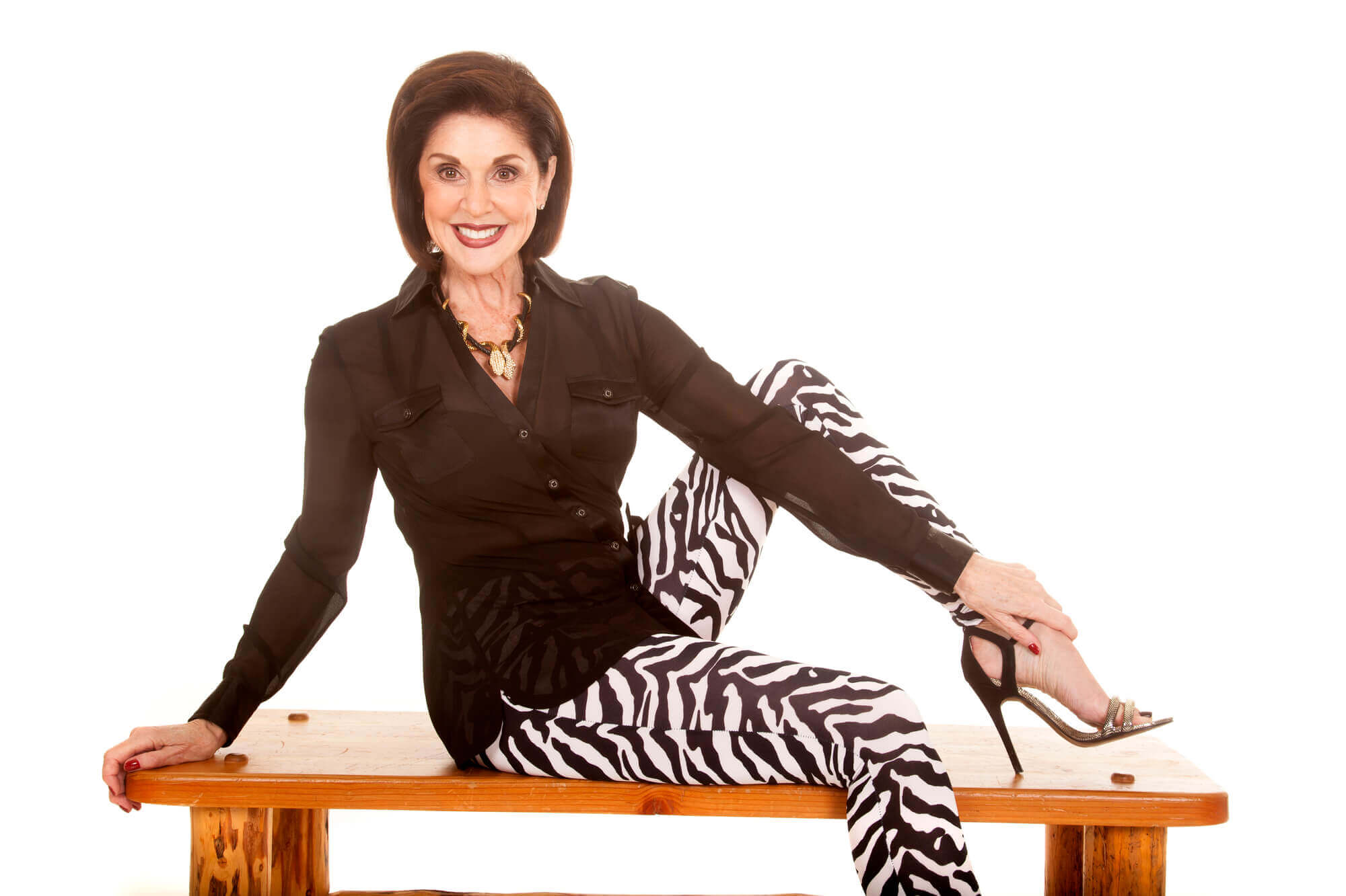 woman in zebra pants on bench