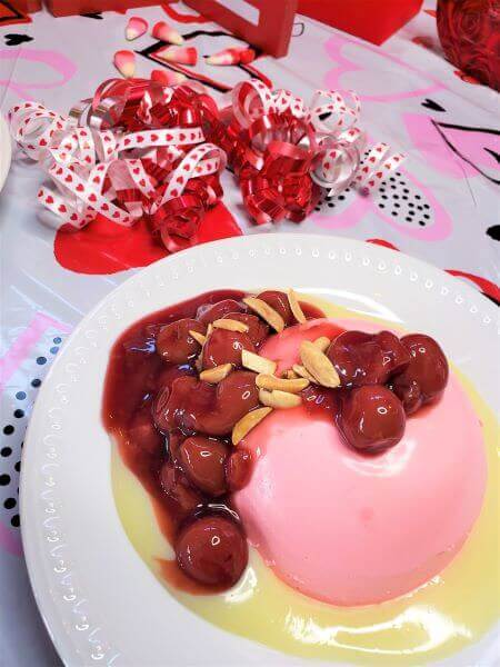pink panna cotta with white chocolate and cherries