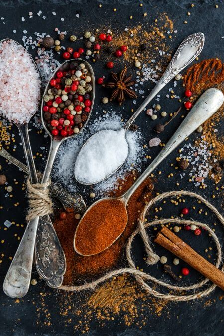 spices on slate in spoons