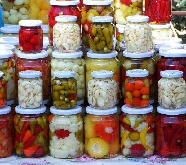 stacked jars of pickled foods