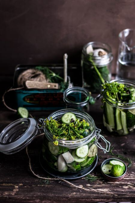 homemade pickles in jars with garlic and dill