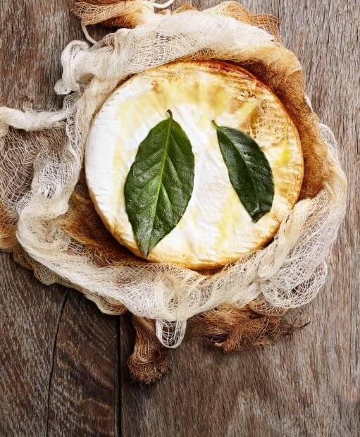 smoking food at home recipes smoked brie with bay leaves on top