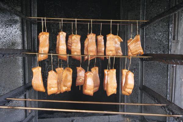 smoked fish hanging in smoker