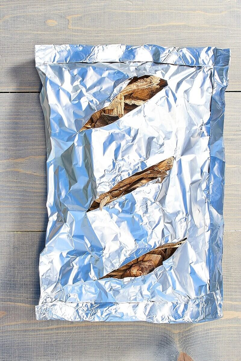smoking food at home foil packet of wood chips