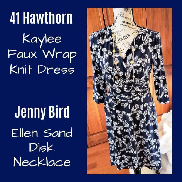 navy and white print wrap dress with necklace on mannequin