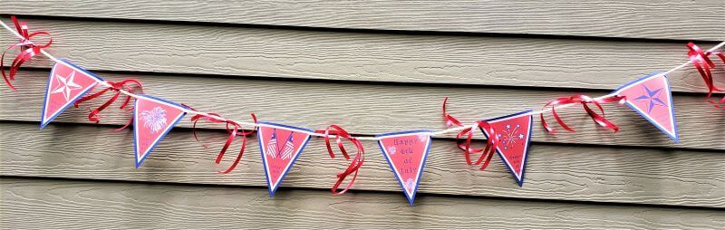 4th of July pennant banner on side of house