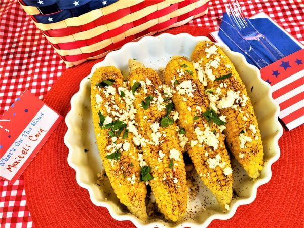 mexicali corn on the cob with red white and blue decorations