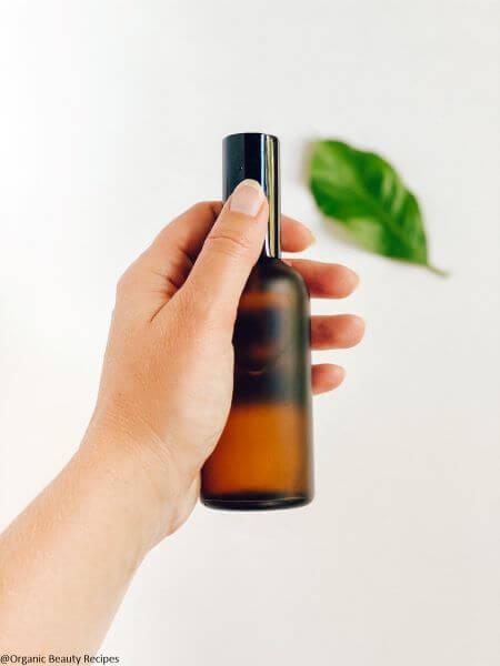 organic bug repellent in brown bottle