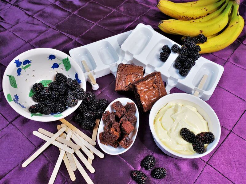 banana blackberry and brownie pops on ice in silver tray