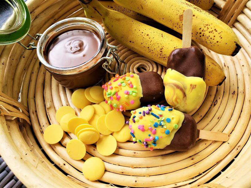 banana pops dipped in chocolate hazelnut topping and yellow chocolate