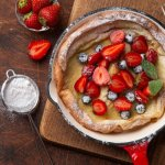 dutch baby with berries and lemon sugar
