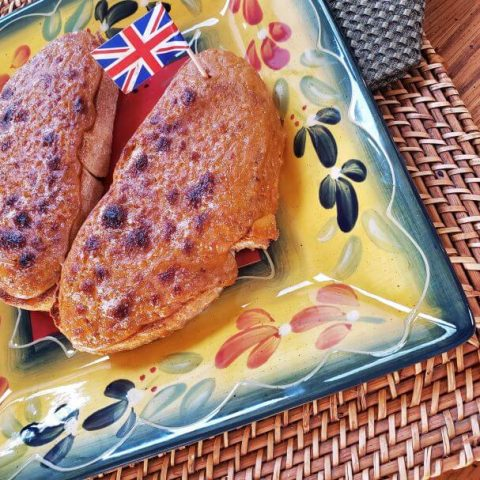 bold welch rarebit with the British flag decoration on square plate