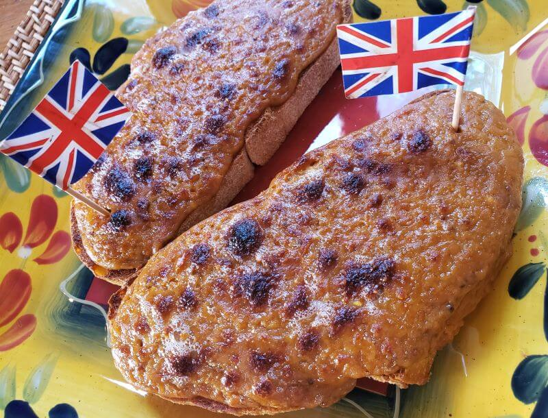bold Welch rarebit with British flags on square plate