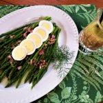 asparagus with caper dill vinaigrette on platter