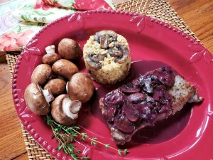red wine and mushroom pan sauce on steak with risotto