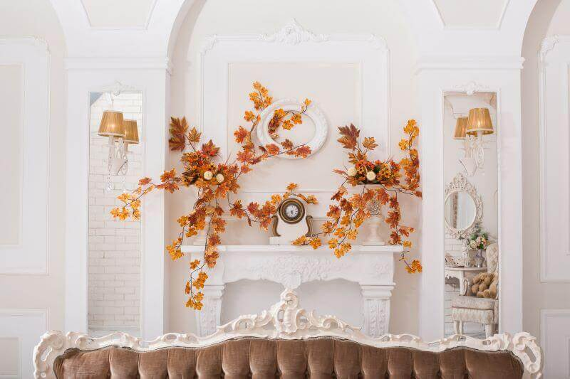 fall leaves decorating a mantle for thanksgiving