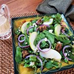 green apple and arugula salad with blue cheese and sugared walnuts