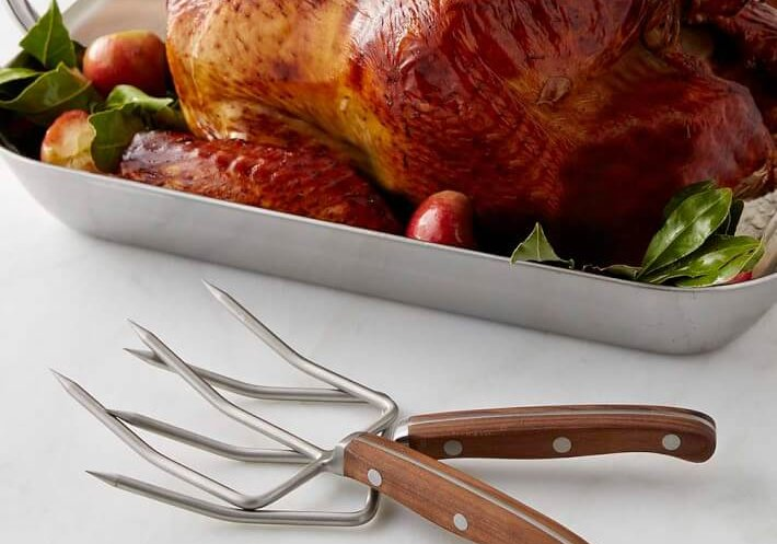 walnut handled poultry lifter forks with whole turkey in roaster