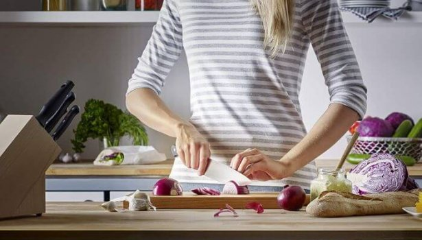 sharp carving knife being used by woman
