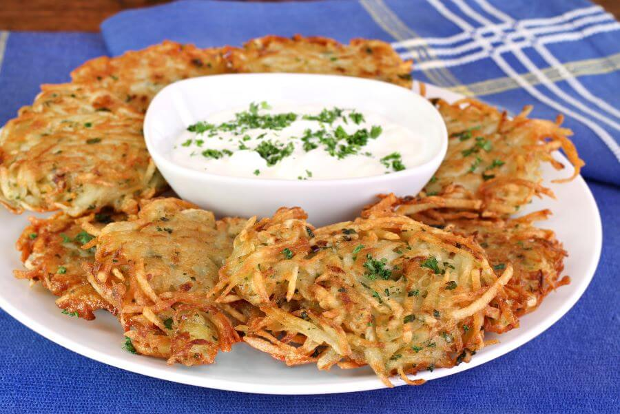 gourmet latkes with sour cream and parsley