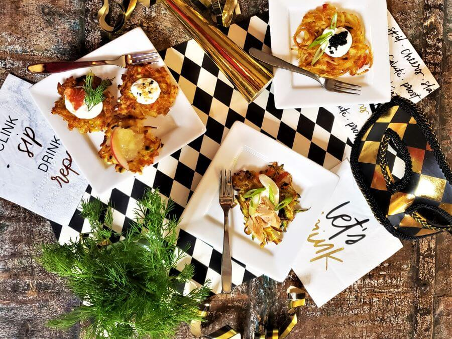 gourmet latkes with fancy topping and new year's eve props