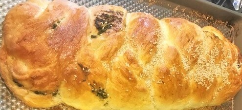 baked loaf of herbed challah