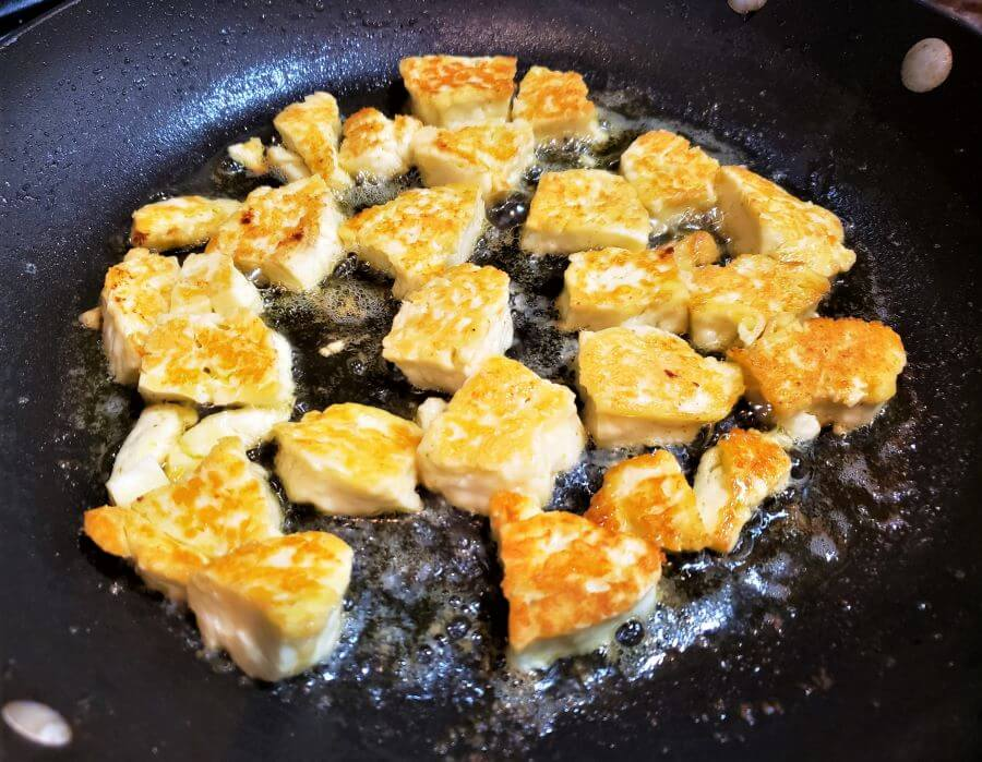 fried halloumi cheese cooking in the pan