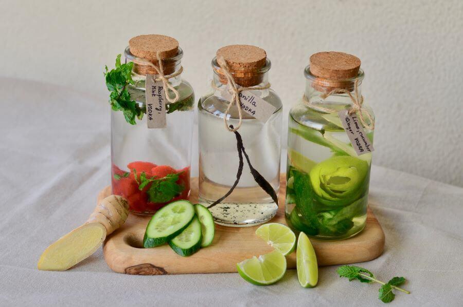 three bottles of infused vodkas