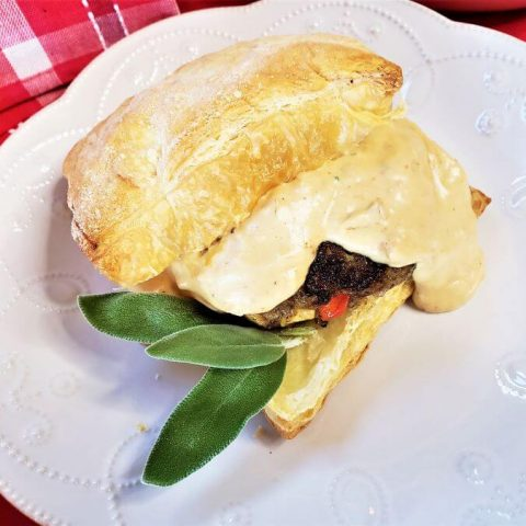 apple sage sausage with caramelized onion cream sauce in puff pastry