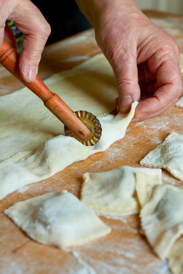 cutting Polish pierogi dough into circles