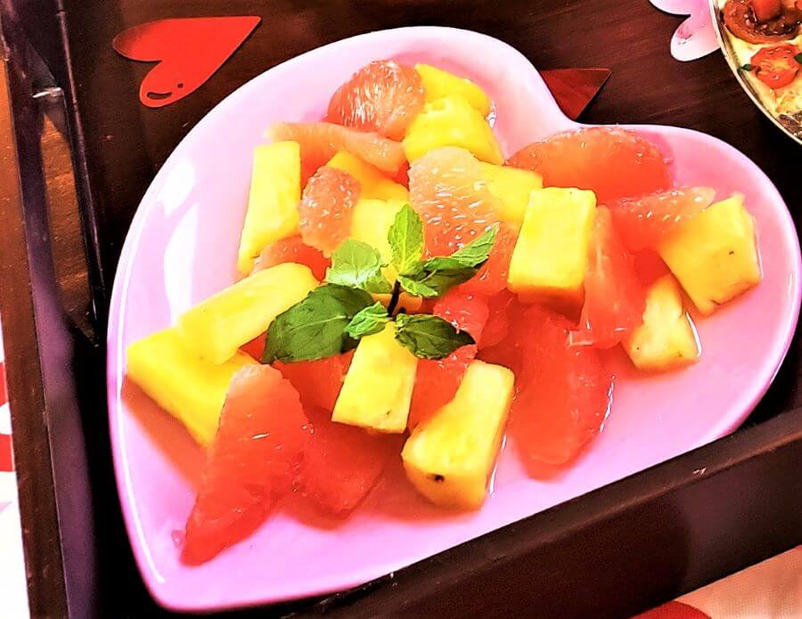 tropical fruit in cardamon spiced syrup