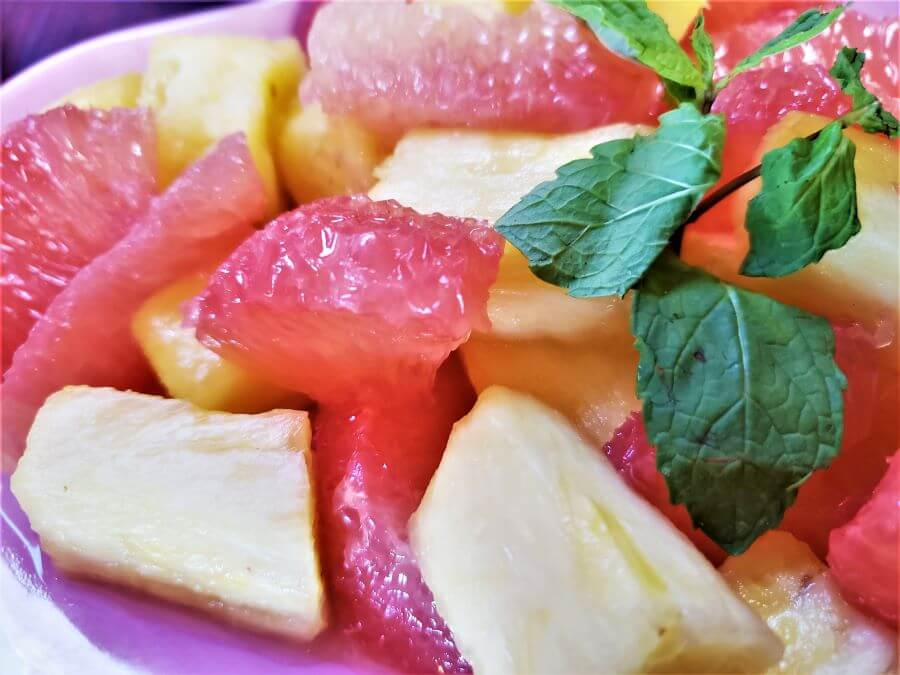 tropical fruits in cardamon spiced syrup