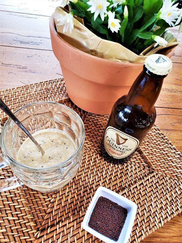 zippy horseradish beer mustard in beer mug with beer bottle