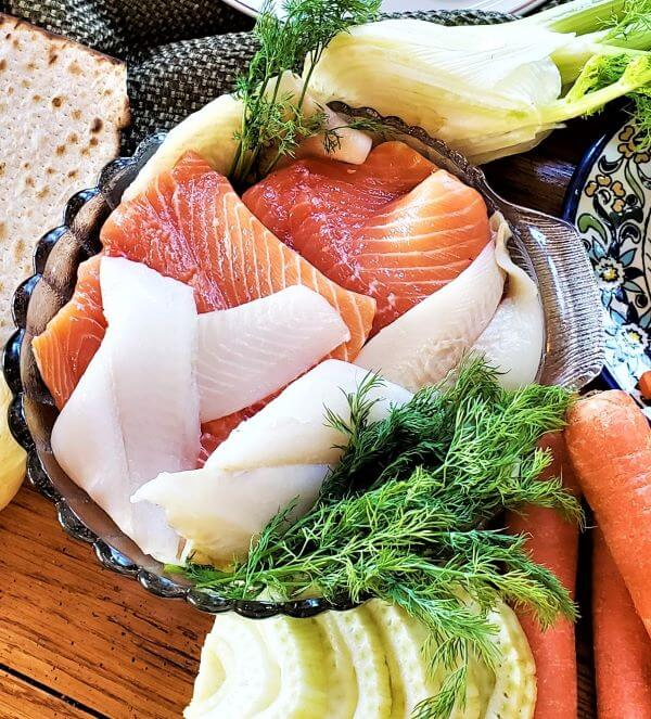 close up of salmon and flounder fillets in bowl