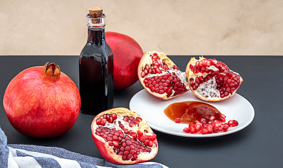 pomegranate molasses in bottle with fruit