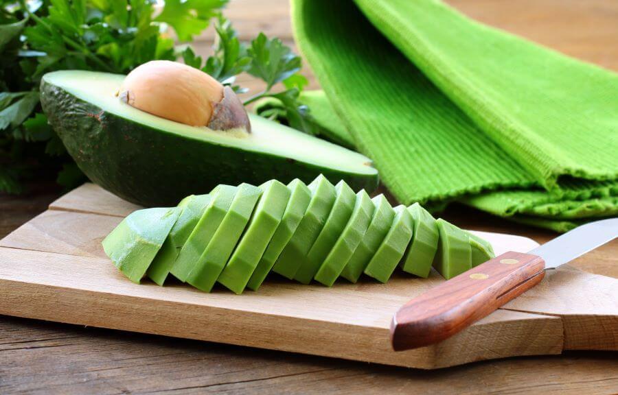 avocado sliced on cutting board