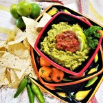 smoky guacamole with cilantro tomato topping