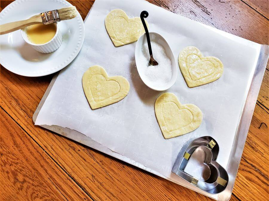 puff pastry hearts unbaked on pan